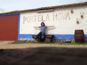 Laura sat on a bench below the Portela Nova sign