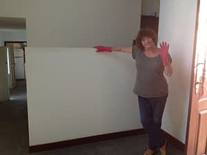 Mum standing next to the wall before we painted it red