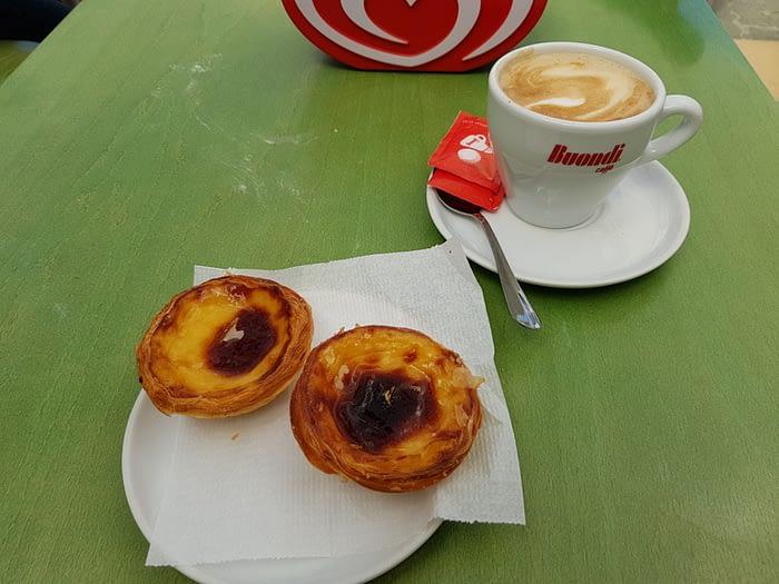 Coffee and two pasteis de natas